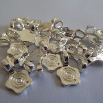10 x Silver plated flower bails