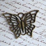 5 x Antique Bronze butterfly Pendants