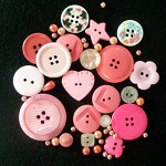 Coral pink beads and plastic buttons mix