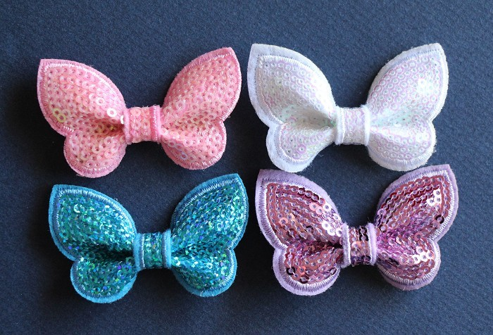 4 Sequin Butterflies/ Bows 4 Colours