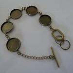 15 x Bronze bracelets each with 5 x 16mm trays