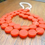 1 x strand 10mm resin coin solid orange