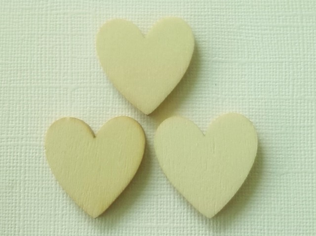 3 pack of wooden heart embelllishments. Buy a 3 pack receive another for FREE!