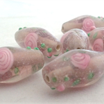 6 x Pink handblown glass beads with flower inlay