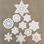 Pack of 11, white crochet  snowflake motive, medium size, appliqué