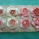 8 stiff paper rose embellishments