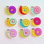 9 x Snail wooden buttons in assorted colors