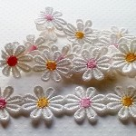 White Daisy Lace with pink and yellow centres 26mm - sold in metre lengths