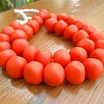 Resin nuggets solid orange 15 x 10 mm approx 34 per strand
