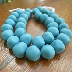 Resin nuggets solid sky blue 15 x 10 mm approx 34 per strand