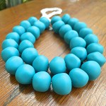 Resin nuggets solid teal 15 x 10 mm approx 34 per strand