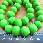 Resin nuggets solid lime green 15 x 10 mm approx 34 per strand