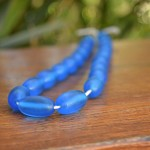 Blue resin jelly bean beads 1 x strand of 21 beads