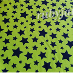 Black stars on lime green medium weight cotton lycra stretch knit. 4 way stretch