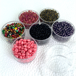 6 pots of seed beads- pinks and purples