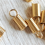 70+ Gold plated Leather coil ends