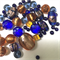 50 x mixed glass and crystal beads- dark blue and golden brown