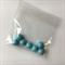 7 blue gumball beads