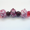 Lampwork Glass bead set consisting of 7 beads in  transparent amethyst & pink