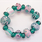 Lampwork Glass Bead Set in teal green and pink. 18 beads,