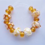 Lampwork Glass Bead Set, 15 beads in transparent topaz/amber