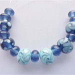 Lampwork Glass bead set consisting of 15 beads in  transparent and opaque blue