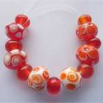 Lampwork Glass Bead Set in red and white. 13 beads, 6 design beads and 7 spacers