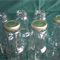 Glass sauce bottles with new lids x 45