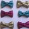 Stiff glitter bows x 6