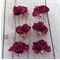 Pendants, fabric flower tassels, blue and maroon.