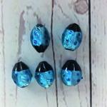Beads, glass ladybugs, blue and black.