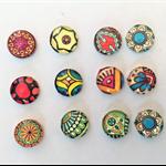 Cabochon beads, glass, round, flat backed, mandala patterned.