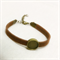 7 slim leatherette Bracelets with bronze bezels