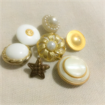 7 vintage gold and pearl buttons
