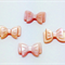 Natural Pink Carved Shell Bow Beads