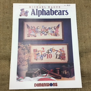 Dimensions Leaflet by Michael Hague, Alphabets and Numbers