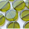 Czech Pressed Glass Transparent Olive 12mm Flat Round (20 Pieces)