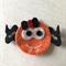 Orange spider felt embellishment