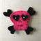 Pink skull and cross bones felt embellishment