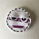Mummy face felt embellishment