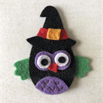 Black owl in a hat felt embellishment