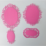 Die Cut Lace Bordered Ovals.