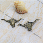 Large Bronze tone detailed Bull  horns charm pendant
