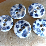Round buttons with butterflies