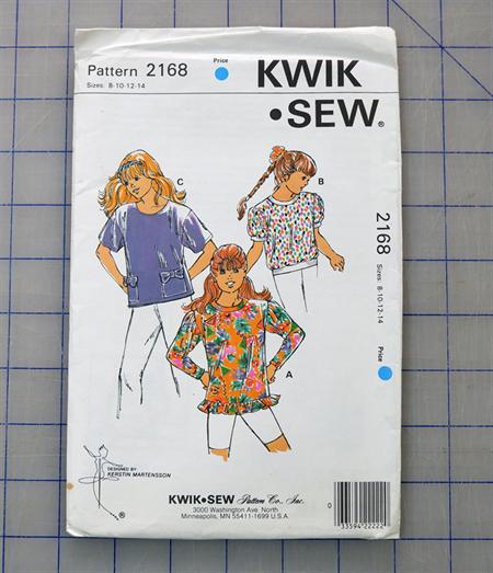 Kwik Sew 2168 uncut pattern for a girls top. Sizes 8 - 14