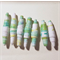 Handmade paper beads set of seven in green and white  beads.