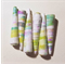 Handmade paper beads set of six in green and white bell shaped beads.