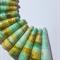 Handmade Designer bell shape paper beads, in shades of green set of 11