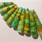 Handmade Designer bell shape paper beads, in shades of green set of 9